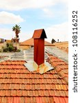 Old Jerusalem red tile roof with pipe - stock photo