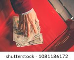 Paying For the Car. Caucasian Men Giving Thousand Dollars For the Aged Classic Car. - stock photo