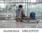 young traveler man sitting on... | Shutterstock . vector #1081229255