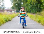 little cute kid boy on bicycle... | Shutterstock . vector #1081231148