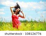 Happy Beautiful Woman Dancing...