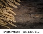 wheat ears on rustic wooden... | Shutterstock . vector #1081300112
