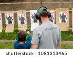 gun instructor teaching young... | Shutterstock . vector #1081313465