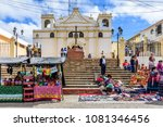Small photo of Santiago Sacatepequez, Guatemala - November 1, 2017: Local Maya people including women dressed in traditional clothing outside church in town with famous giant kite festival on All Saints' Day.