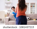 wife unhappy that husband is... | Shutterstock . vector #1081437215