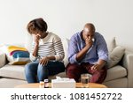 couple sick at home on the sofa | Shutterstock . vector #1081452722