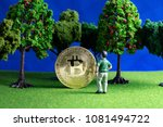 bitcoin found by a tiny man  in ... | Shutterstock . vector #1081494722