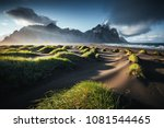 Small photo of Unique view on the green hills with sand dunes. Location Stokksnes cape, Vestrahorn (Batman Mount), Iceland, Europe. Scenic image of amazing nature capture. Summer scene. Discover the beauty of earth.
