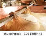 a cheesemaker prepares a form... | Shutterstock . vector #1081588448
