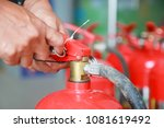 hand pulling pin of fire... | Shutterstock . vector #1081619492