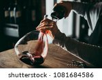 pouring red wine into a... | Shutterstock . vector #1081684586