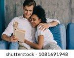 multiracial embracing young... | Shutterstock . vector #1081691948