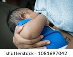 mother feeding milk from breast ... | Shutterstock . vector #1081697042