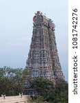 Small photo of One of the 4 principal Gopurams, or entrance towers, of the 45 acre Meenakshi temple complex at Madurai in Tamil Nadu, India. It is only in the last century that the temple carvings have been painted