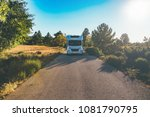 Front view of a motor home on a mountain path on a sunny day. Copy space area available - stock photo