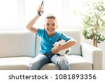 boy with soccer ball listening... | Shutterstock . vector #1081893356