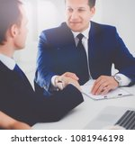 businessmen shaking hands ... | Shutterstock . vector #1081946198