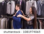 girl seller helps to pick up a... | Shutterstock . vector #1081974065