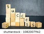 ladder made of wooden cubes... | Shutterstock . vector #1082007962