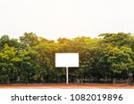 Small photo of Blank white billboard The back is full of trees. Copy space.