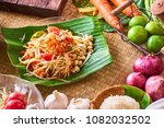 papaya salad  som tam    thai... | Shutterstock . vector #1082032502