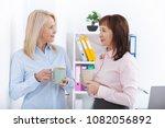 office coffee break. two female ... | Shutterstock . vector #1082056892
