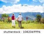 senior couple hiking in... | Shutterstock . vector #1082069996