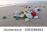 plastic bottle caps on the beach | Shutterstock . vector #1082086862