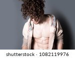attractive young man with long... | Shutterstock . vector #1082119976
