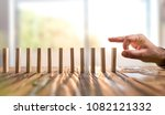 domino effect. just starting or ... | Shutterstock . vector #1082121332