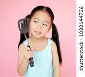asian little girl holding a...   Shutterstock . vector #1082144726
