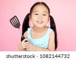 asian little girl holding a...   Shutterstock . vector #1082144732