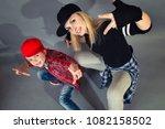 mother and son dance hip hop... | Shutterstock . vector #1082158502
