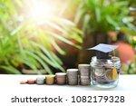 hat graduation model on coins... | Shutterstock . vector #1082179328