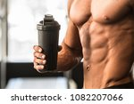 man with perfect body holds... | Shutterstock . vector #1082207066
