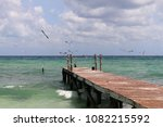 wooden pier in a coast of... | Shutterstock . vector #1082215592