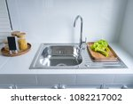 stainless steel kitchen sink on ... | Shutterstock . vector #1082217002