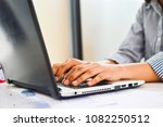 bored young woman in the office ... | Shutterstock . vector #1082250512