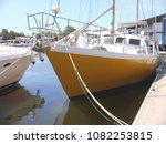 yellow yacht moored at peaceful ... | Shutterstock . vector #1082253815