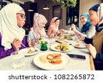 islamic women friends dining... | Shutterstock . vector #1082265872