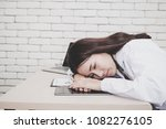 young female doctor sleeping at ... | Shutterstock . vector #1082276105