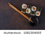 sushi roll with soy sauce. top... | Shutterstock . vector #1082304005