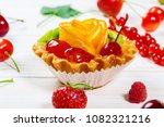 delicious fruit cake on white... | Shutterstock . vector #1082321216