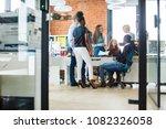 gossiping staff at work.... | Shutterstock . vector #1082326058
