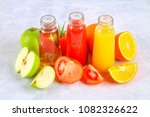 bottles with fresh orange ... | Shutterstock . vector #1082326622