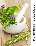 healing herbs in white ceramic... | Shutterstock . vector #108233282