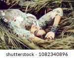 beautiful hippie girl lying in... | Shutterstock . vector #1082340896