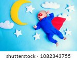 little baby superhero with red... | Shutterstock . vector #1082343755