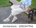 fashion woman wearing beige... | Shutterstock . vector #1082347946