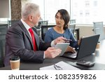 two business colleagues working ... | Shutterstock . vector #1082359826